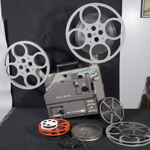 Vintage 16 mm movie projector and 16 mm films