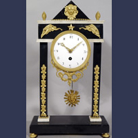 Antique Neoclassical bronze mounted black marble mantel clock