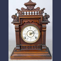 Victorian Welch walnut wood gingerbread clock . Connecticut made