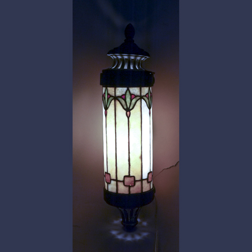 Antique leaded stained glass sconce from a steam train parlor car.