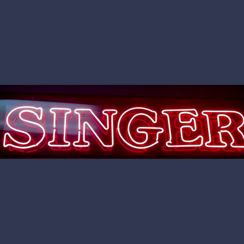 Vintage Singer sewing machine advertising neon sign