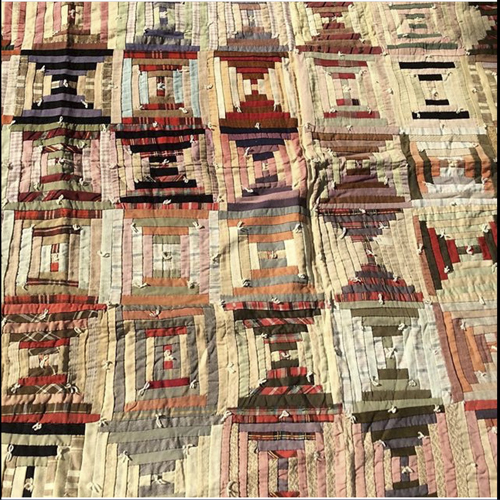 Antique hand stitched quilts and blankets