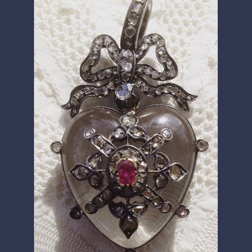 Victorian European mine cut diamonds , ruby ,silver and quartz crystal heart locket